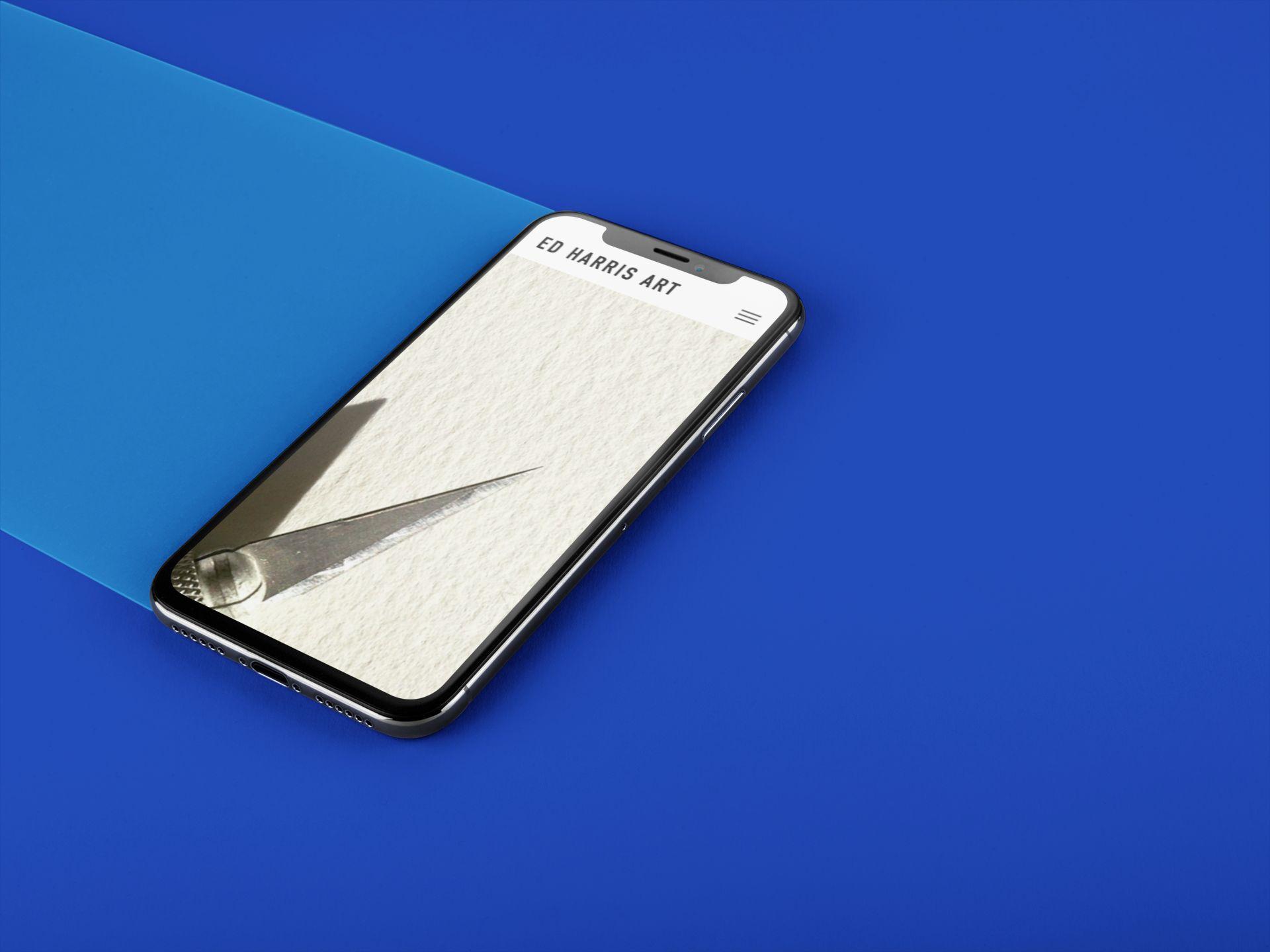 iphone-x-mockup-lying-on-a-double-colored-surface-a20086